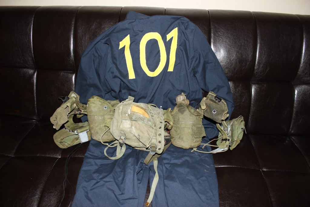 A Vault 101 jumpsuit with an army belt