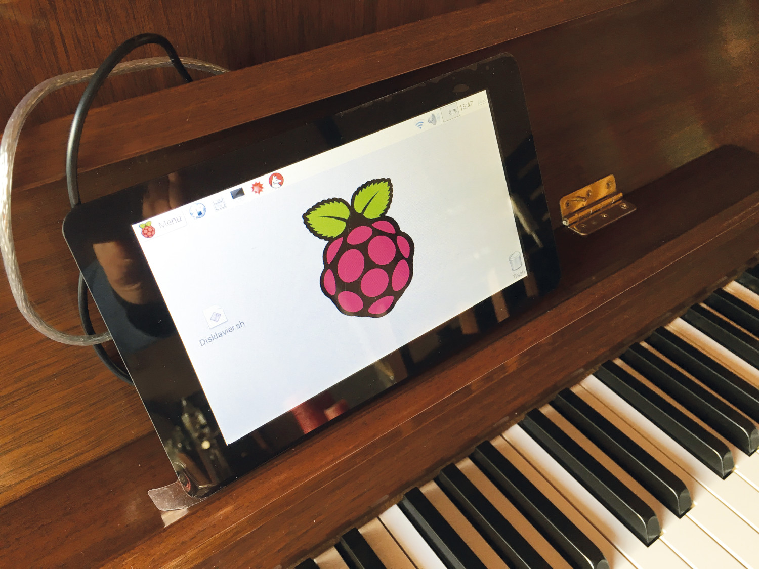A Pi proudly playing a piano